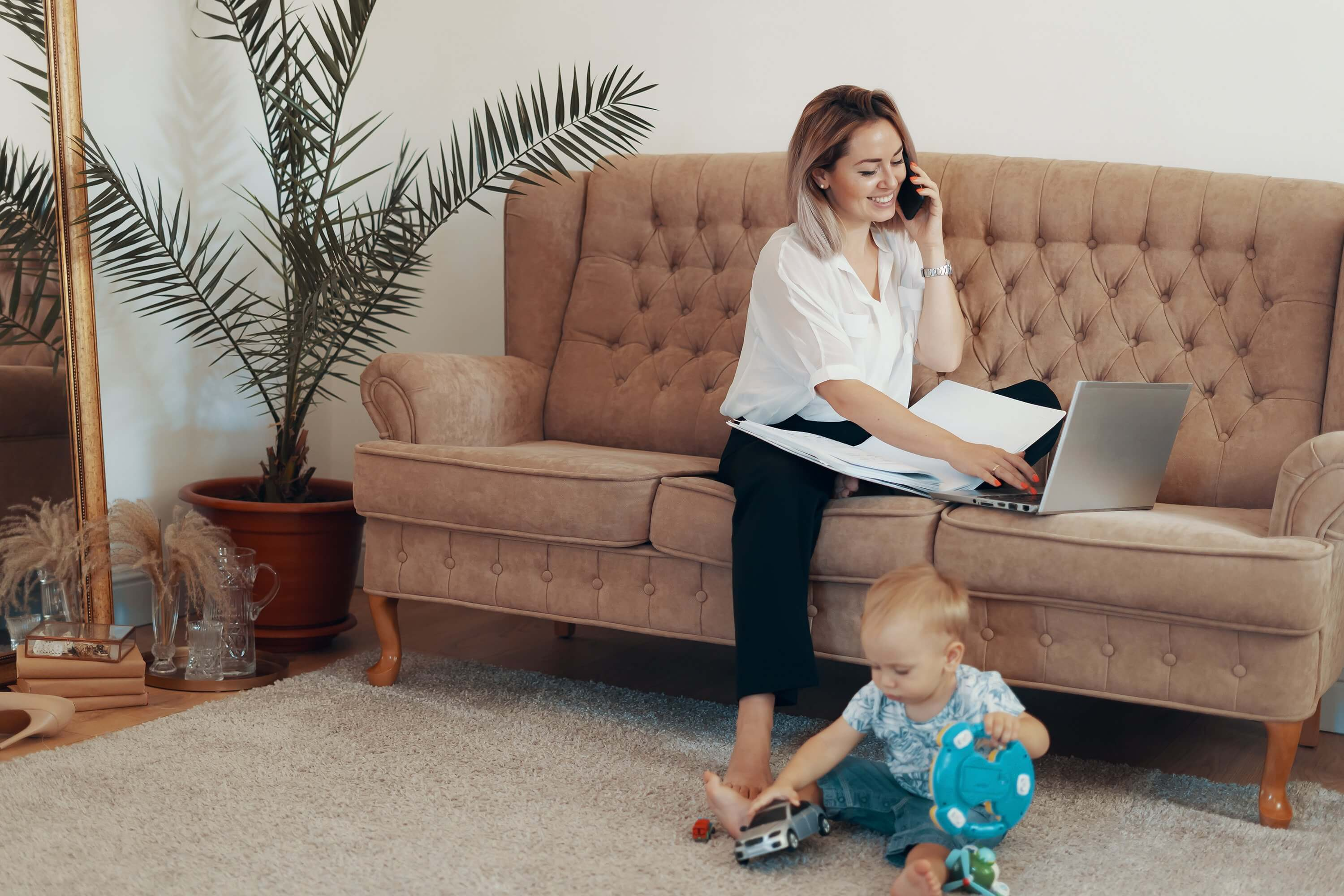 beautiful business woman working at home multi tasking freelance and motherhood concept